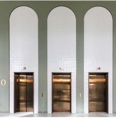 Decorative lobby hall with subway tiles shaped within arches