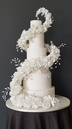All white wedding cake with cascading white sugar flowers made with ChocoPan by . - All white wedding cake with cascading white sugar flowers made with ChocoPan by Satin Ice Covering - Big Wedding Cakes, Luxury Wedding Cake, Elegant Wedding Cakes, Elegant Cakes, Beautiful Wedding Cakes, Wedding Cake Designs, Wedding Cake Toppers, Wedding Vendors, Extreme Wedding Cakes
