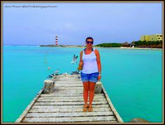 """Stroll the docks at Dreams Cancun Resort and admire the amazing water color. Find out more at """"Down the Wrabbit Hole - The Travel Bucket List"""". Click the image for the blog post."""