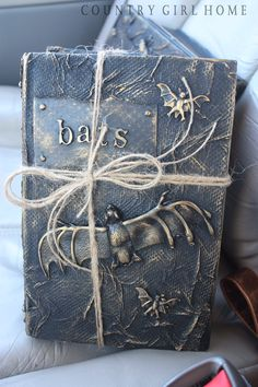 Cool Idea from Country Girl Home. How to make your own old Halloween books with thrift store books, mod Podge, plastic decorations, spray paint. These look like Ancient Wisdom -- LOL! Diy Halloween Books, Halloween Spells, Halloween Projects, Diy Halloween Decorations, Holidays Halloween, Scary Halloween, Halloween Ideas, Halloween Party, Country Halloween