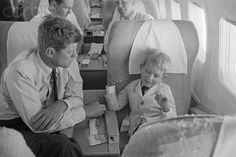 John Kennedy listens to his nephew Bobby Kennedy Jr. explain how the plane flies from Los Angeles to Boston as they return home from the Democratic National Convention, 7/17/60. Bettman/CORBIS