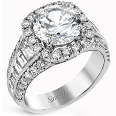 Large Center Halo Diamond Engagement Ring Featuring 0.88 Carat Round Cut Diamonds and 1.03 Carats Baguette Cut Diamonds in 18K White Gold by Simon G. available at BenGarelick.com starting at $8140 https://www.bengarelick.com/products/simon-g-large-center-halo-diamond-baguette-cut-engagement-ring