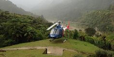 The rescue helicopter lands on the lawn of the Bridge to Nowhere Lodge to pick up an injured man. Herald News, Photo Supplies, Jet Boat, Boat Tours, Man Photo, Auckland, Canoe, Mountain Biking, Wilderness
