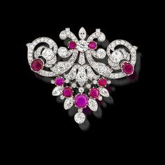 A ruby and diamond brooch/pendant, c. 1915