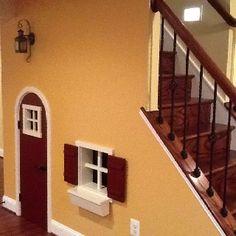 Kids cottage under stairs by Centofanti Design & Build