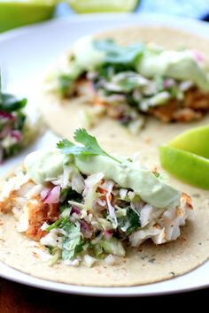 Crispy Fish Tacos with Avocado Sauce and Cilantro Slaw
