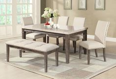 Try sitting at the Aldo 6-piece dining set without feeling nostalgic for the dry hills of Spain. The entire collection has the light, powdered feel of the Old World, showcased by the Spanish marble tabletop. The frame is built of Chinese ash, wire-brushed and stained in a grey-brown finish to lend the necessary maturity for this sentiment. Around the table, the seats are upholstered in a beige linen fabric, which appears soft and gentle alongside the lightly distressed wood and bronze…