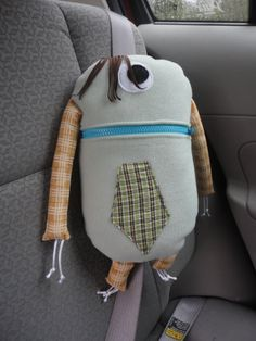 Travel Buddy  Monsters, seat belt pillow that is washable and have their very own name and kids LOVE em...