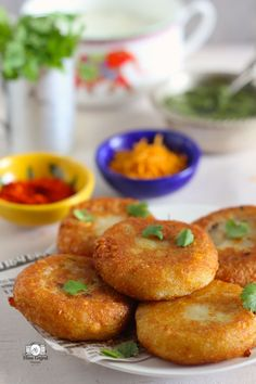 Aloo Tikki Chaat Recipe is hard to give a miss if you are on a tour to devour Indian Street Food. These simple burger patty like fritters are prepared with potato… No Bake Snacks, Savory Snacks, Snack Recipes, Cooking Recipes, Snacks Ideas, Quick Snacks, Rice Recipes, Vegetarian Recipes, Dessert Recipes