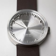 Those who prefer larger more eye-catching timepieces might prefer the Tube watch by LEFF amsterdam with a 42mm case. Its shiny steel case is juxtaposed by a dark brown leather strap which holds it firmly on the wearer's wrist. #designerwatches #steel #brown #leffamsterdam #pietheineek