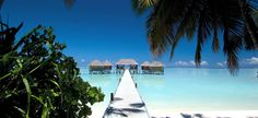 Twin island resort, containing a luxurious range of beachfront and overwater villas connected by a wooden footbridge and regular dhoni service.  http://www.abercrombiekent.co.uk/maldives/conrad-maldives-rangali-island.cfm
