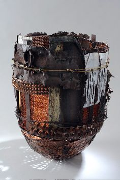 New Age Basket 5 by John Garrett Fiber construction with alternative and recycled materials, including wire, hardware cloth & metal.