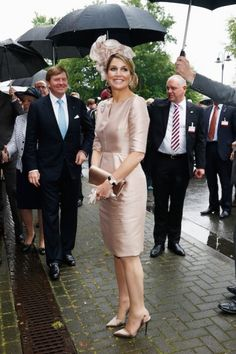 The queen in her famous Natan dress. Click on the image to see more looks.