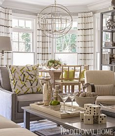Tall bookshelves and a two-tiered coffee table ensure there is plenty of space for books and games—always in demand at a vacation home. - Design: Patricia Fisher
