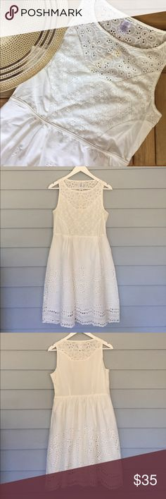 """Eyelet Sundress Does anything say springtime more than a lovely white eyelet sundress? So much detail on this adorable little number! Side zipper. Fully lined. Tailored waist for a ultra flattering fit! Fabric: cotton, nylon, rayon. Size M. Measures approx. 36"""" from shoulder to hem, 34"""" bust, 30"""" waist. Item is new, direct from designer without tags! Tags: beach poolside coverup spring summer party event office work vacation festival cruise tropical wedding Boutique Dresses Mini"""