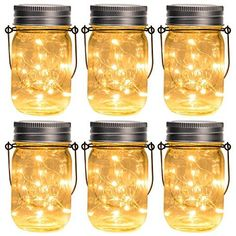 """GIGALUMI Hanging Solar Mason Jar Lid Lights, 6 Pack 30 Led String Fairy Lights Solar Laterns Table Lights, 6 Hangers and Jars Included. Great Outdoor Lawn Décor for Patio Garden, Yard and Lawn. All in One Hanging Solar Lights: 6-Pack(6 Mason Jars+6 Lid lights+6 Hangers). Mason Jar Dimension: 3.2"""" Dia. x 5.3""""H Multiple Uses: 2 ways to install these solar lights - Hang them on places where can get the sunlight during the daytime, or make the lights sit on the ground or table as a mood lamp Solar p Solar Hanging Lanterns, Solar String Lights, String Lights Outdoor, Hanging Lights, Mason Jar Solar Lights, Mason Jar Lighting, Mason Jar Lanterns, Solar Christmas Decorations, Christmas Lights"""