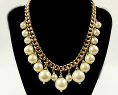 This thick gold link chain statement necklace is adorned with cascading strands of white faux pearls. Pair with a plain shirt underneath to make this piece stand out! Great for yourself and makes a perfect gift! :)   Visit my store at http://stores.ebay.com/tried-and-trendy