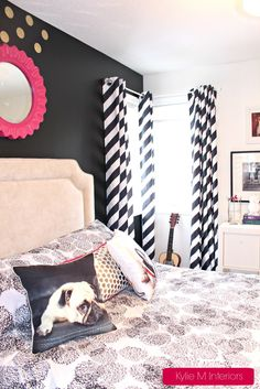 Teen or tween decorating and paint colour ideas. Black feature wall with Benjamin Moore Simply White and pink accents. Dog cushions for fun! Kylie M Interiors
