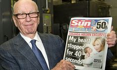 Great piece by Russell Brand.  Rupert Murdoch with the first issue of the Sun on Sunday. Photograph: Arthur Edwards/AFP/Getty
