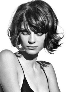 Wavy Hairdo with Short Bangs - (seriously? these are not short bangs.....)
