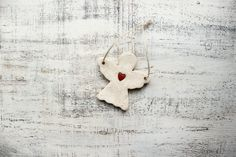 Set of 10 angel ornaments heart ornament Scandi Christmas ornament Scandinavian Christmas decoration rustic cottage chic shabby chic red white 4 inches. Lovely primitive angel ornament with a little red heart. Both sides are decorated in the same way (handpainted). This can be a great touch of rustic & Scandinavian style. It can be a sweet Christmas ornament or Christmas decoration, holiday decor in shabby chic or cottage chic style. The size of each angel is about 9 cm long and wide or...