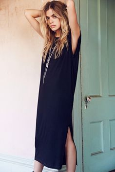 Love this long black t shirt dress and her natural ombré locks.