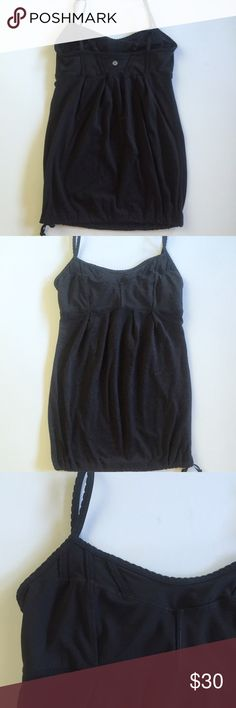 Black Lululemon drawstring tank Very good condition, no pulling, holes or stains. It is missing the toggle at the bottom so it is just tied. Built in shelf bra with openings but no padding. Adjustable straps. Bundle and save 20%! lululemon athletica Tops Tank Tops