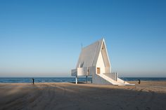 Completed in 2015 in Qinhuangdao, China. Images by 陈颢 Chen Hao. We imagine the Seashore Chapel as an old boat drifting on the ocean long time ago. The ocean receded through time and left an empty structure behind,...