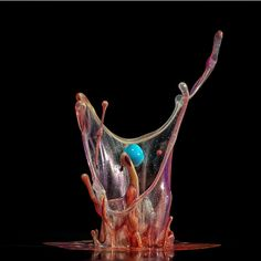 Great photography of paint and water over music vibrations. Artwork and Photograph by MARKUS REUGELS