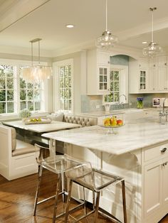 white cabinets with marble countertops