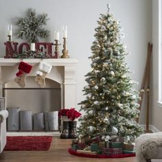 7.5 ft. Pre-lit Flocked Monteray Pine Christmas Tree with Snow Clumps by Sterling Tree Company