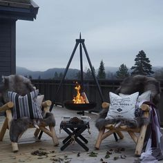 Just love the hanging fire pit. Plenty of soft cushions and blankets too. Outside Living, Outdoor Living, Gothic Home, Cocoon, Winter Cabin, Outdoor Spaces, Outdoor Decor, Mountain Modern, Cabins In The Woods