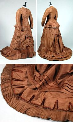 Day dress ca. mid-1870s. Brown silk taffeta comprising long jacket-like bodice with goffered ruffle at hem, and piped in satin. Matching trained skirt with bows front & back. Kerry Taylor Auctions