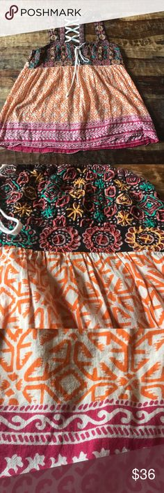 "Free People Lace Up Tank Top Super cute Boho style tank top with lace up back. In excellent condition. Chest is 16"" across laying flat and length is 24"" from shoulder down. Free People Tops Tank Tops"