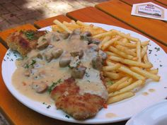 "Jägerschnitzel mit Pommes - ""hunter's schnitzel"" with herbs and mushroom cream sauce."