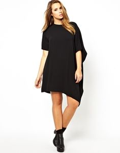 Love the cape and asymmetrical hem, just wondering how it would look on someone with a wide waist like me.