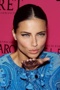 Oh love her how bottom lashes are bare! Adriana Lima is perfection !