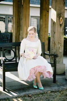 peek of a pink petticoat! photo by Tiffany Hughes Photography http://ruffledblog.com/1950s-inspired-auburn-wedding #weddingdress #vintage