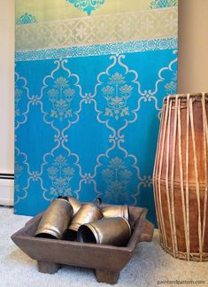 Inspired by Saris: A Shimmery DIY Stenciled Door - I painted this sari-inspired design with Royal Design Studios India stencils on an old closet door. Great way to have a huge canvas!