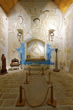 The frescos, which Cocteau called tattoos, were based upon the theme of Christ's resurrection. The artist is buried here with his later… Saint Maximin, Jean Cocteau, Georges Braque, Church Design, Saint Tropez, Sacred Art, Pentagon, Wall Treatments, French Artists