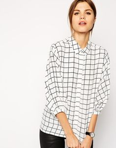 Throw this grid-print blouse over a green pencil skirt or colourful culottes and go walk that walk ;)