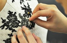 Jason Wu cutting, pinning, sewing lace onto clothes.  Must try myself.