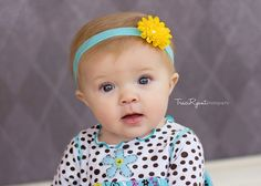 Yellow flower with fancy embellishment on a turquoise headband- newborn, infant, child, teen or adult sizes. $9.00, via Etsy.