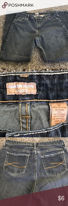 Canyon river blue jeans Good shape canyon river jeans then hems are a little worn as in pictures and on side of the back leg had a crease line ..not sure why that happened but still really good Durable and comfy jeans lots of life still canyon river Pants Boot Cut & Flare
