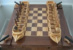 Wooden Ships Chess Set: Cool handmade wooden chess set features two ships.