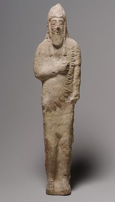 "Standing male figurine of an ""Assyrian"" type  Period:     Cypro-Archaic Date:     mid-7th–end of the 6th century B.C. Culture:     Cyriot"