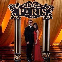 Our Paris Arch features a black and gold sign that says Paris with the Eiffel Tower as the A with coordinating columns.