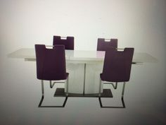 Extending white gloss table with four purple faux leather chairs - £995 Furniture Village