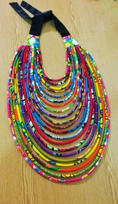 Shopie Multiple cords African print necklace handmade with 100 % cotton African Wax print fabrics. This is an elegant and unique rope necklace made of the rich African Ankara fabric. It has a middle knot to accentuate the uniqueness of the necklace African Necklace, African Jewelry, Ethnic Jewelry, Textile Jewelry, Fabric Jewelry, African Accessories, Jewelry Accessories, Handmade Bracelets, Handmade Jewelry