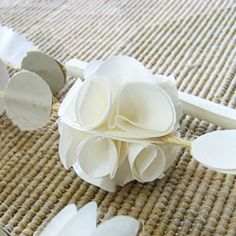 Learn how to make this paper flower, and then make lots of them so you can have your very own paper flower garland.